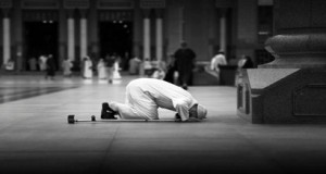 Someone is prostrating during the prayer.