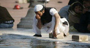A person performing ablution for the prayer