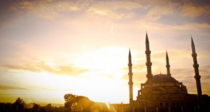 The sunrise over a mosque.