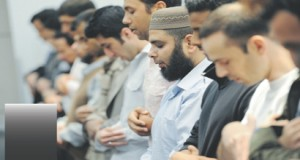 Muslim men are offering prayer.