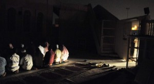Some Muslims offer Fajr prayer in congregation.