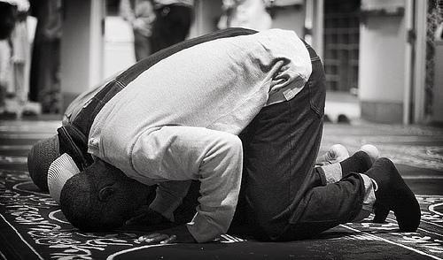 Some Muslims offer prayer in congregation.