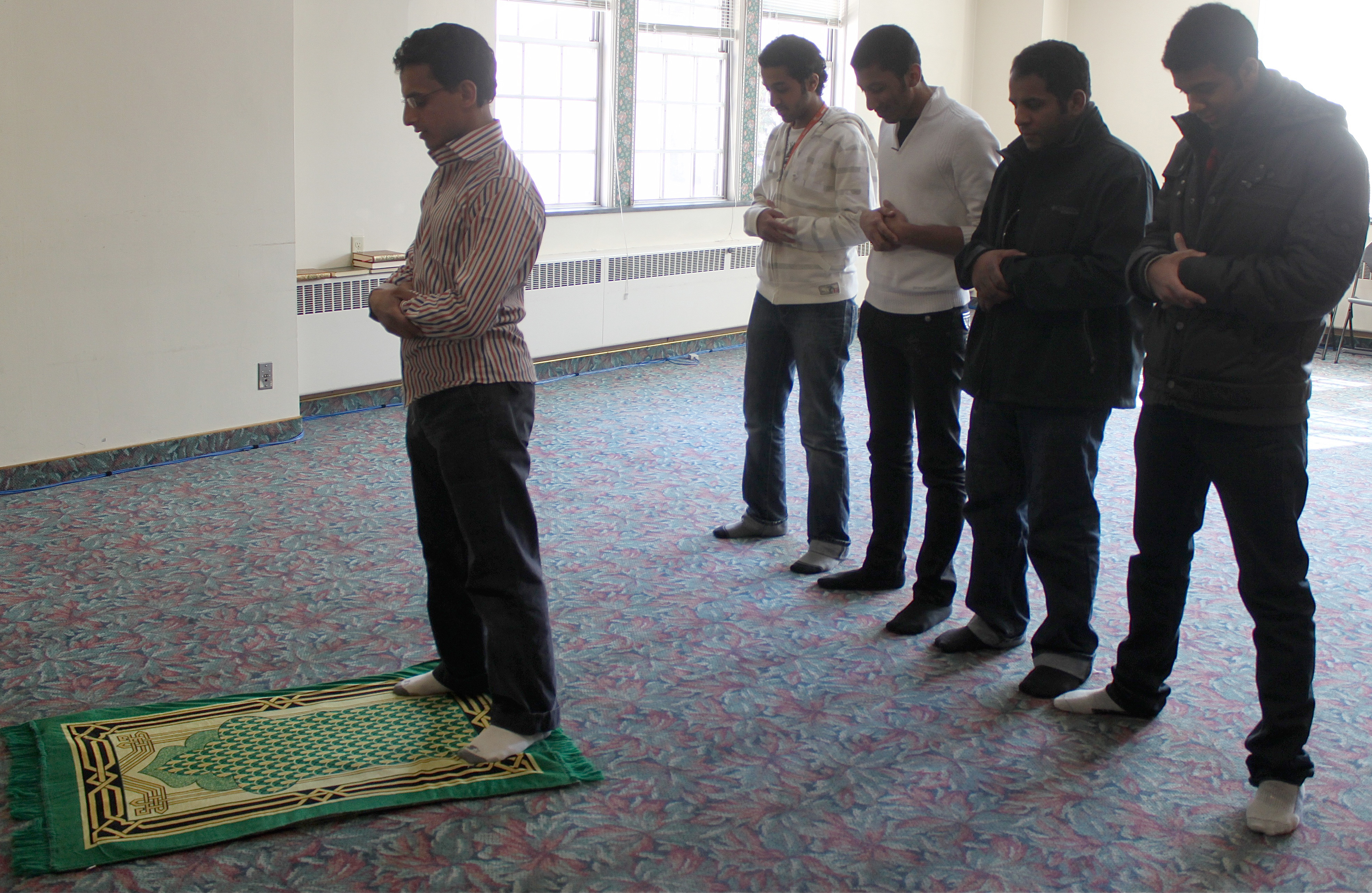 Some Muslim youth offer prayer in congregation.