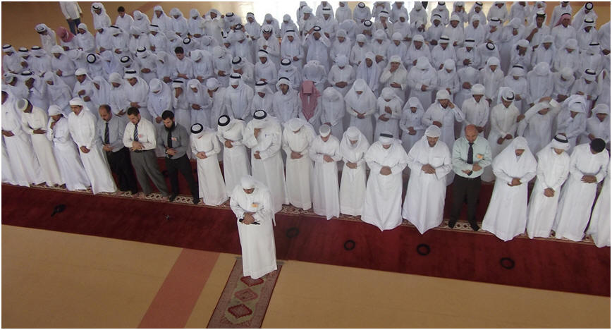 A group of Muslims offer prayer in congregation. Prayer Develops Unity