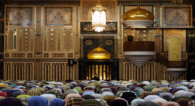 People are offering prayer in a mosque