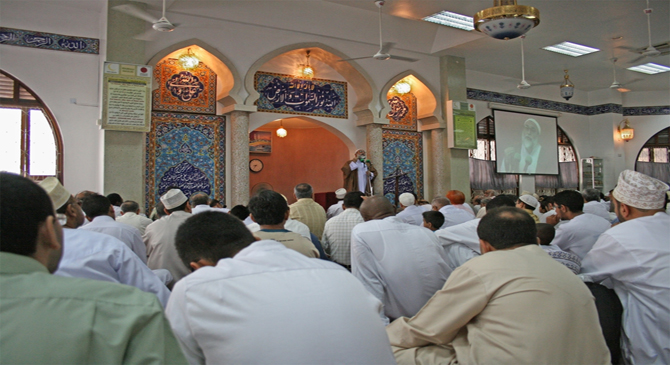Praying people are listening to the Friday khutbah.