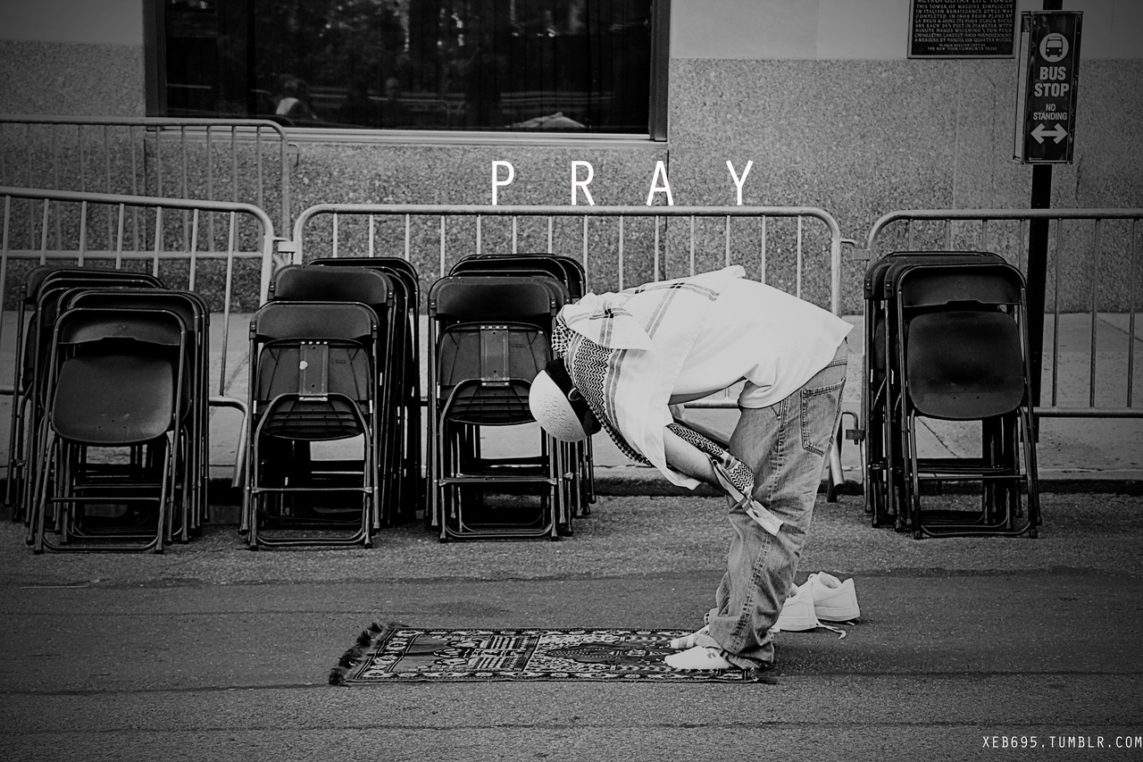 Someone is bowing during his prayer.