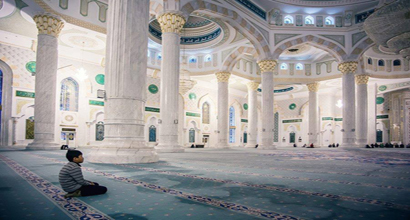a boy in a mosque