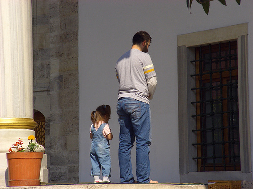 A man and his little daughter offer prayer.