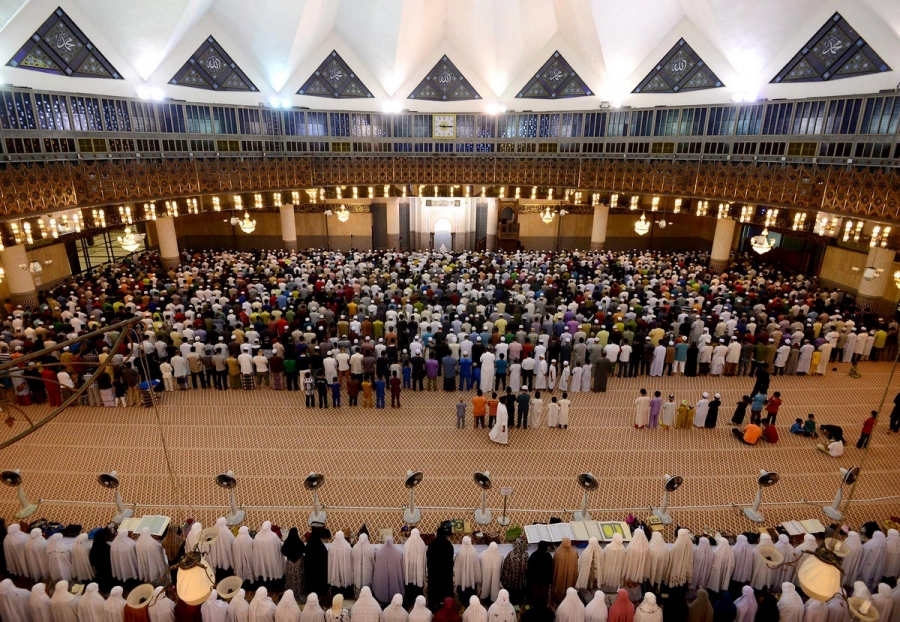 Muslims offer Tarawih prayer at mosque.