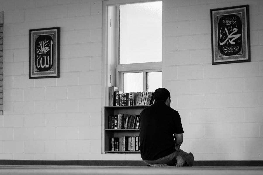 A Muslim sits at a mosque - Fard and Nafl Prayers