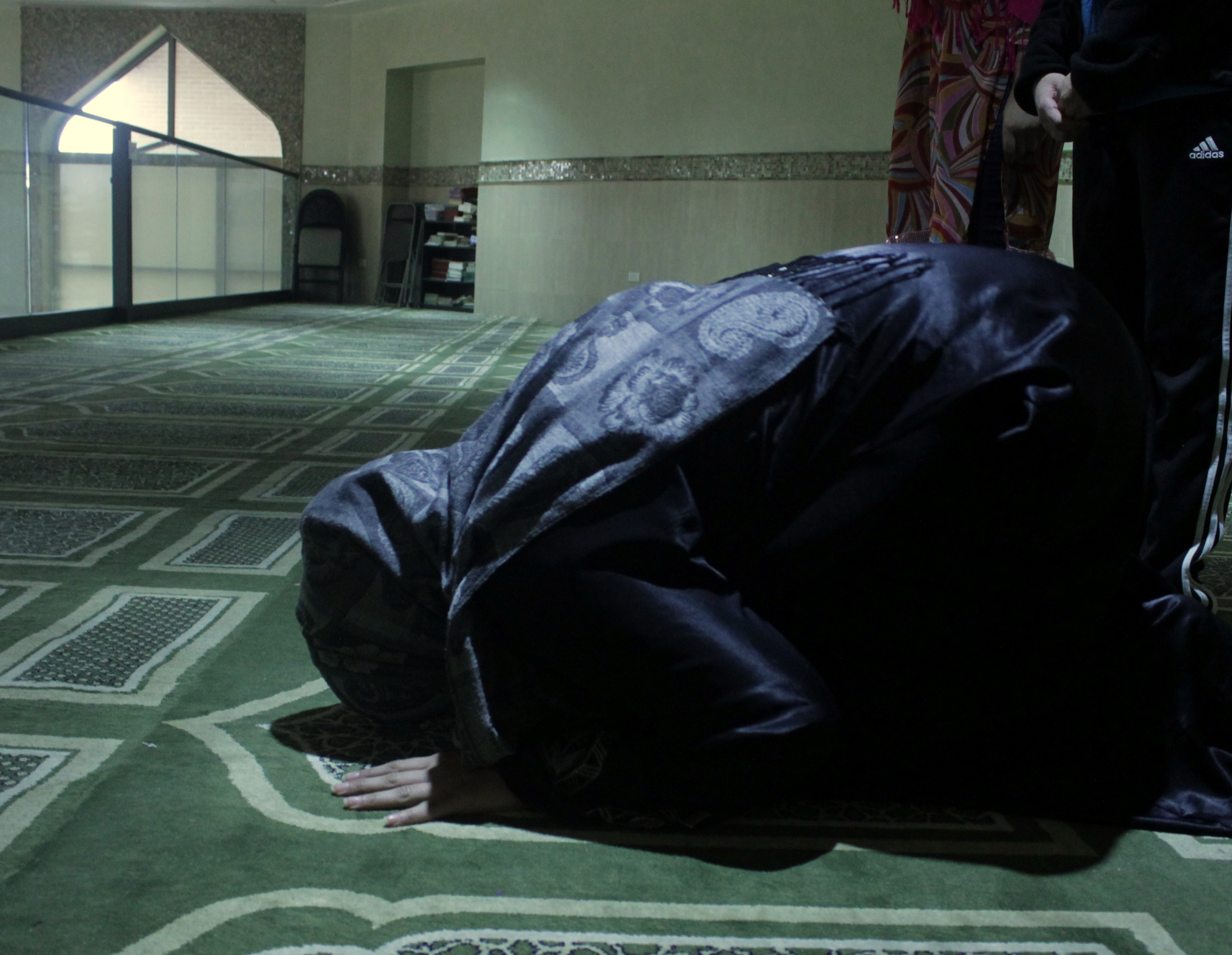 How Should a Woman Prostrate in Prayer?