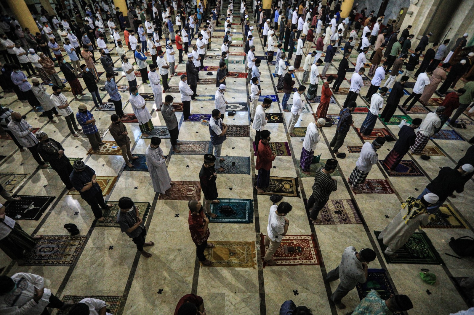 the Ruling of Reciting Al-Fatihah behind the Imam in a Loud Prayer